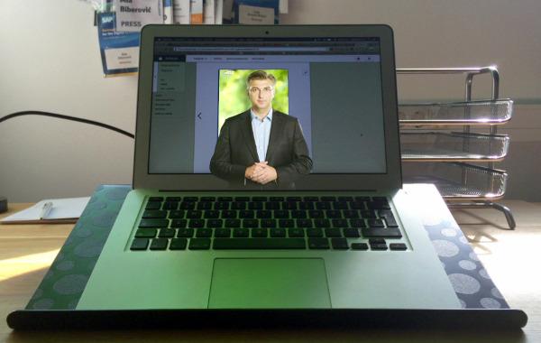 """Ako pokrenete aplikaciju Vjerodostojno i usmjerite kameru mobitela prema plakatu ili slici na kojoj se nalazi predsjednik HDZ-a Andrej Plenković, on će """"oživjeti"""" i moći ćete čuti njegovu poruku."""